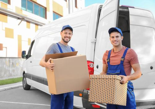 Delivery men from best self storage company with moving boxes